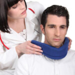 doctor-putting-a-neck-brace-on-her-patient