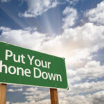 put-your-phone-down-green-road-sign
