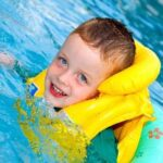 little-boy-swimming-with-life-vest-on