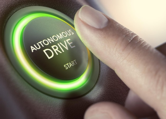 finger touching autonomous car start button