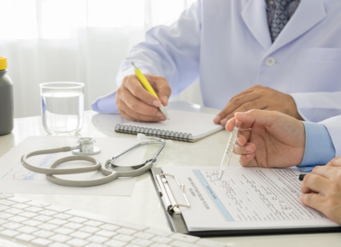 Doctors reading paperwork: Sid Gilreath Medical Malpractice Blog