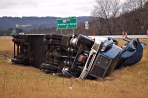 Wrecked tractor-trailer in median: Gilreath & Associates Trucking Accidents Blog
